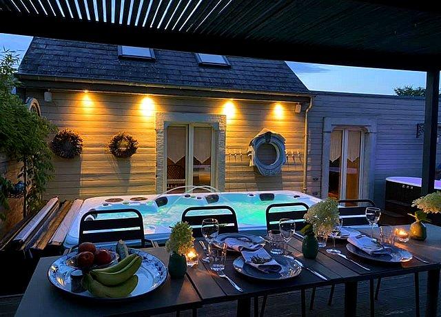 suite de luxe avec jacuzzi privatif exterieur terrasse province du luxembourg esprit de nature
